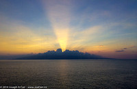 Anti-Crepuscular Rays from a sunset behind clouds on Lanai