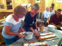 Peggy and Jennifer cut the Apple and Cheese Strudel for dessert at dinner