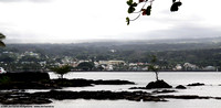 Fisherman on point in Hilo Bay