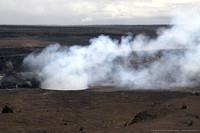 An ash-laden plume rises from a new crater within Halema`uma`u within Kilauea Volcano