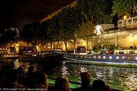 House boats on the Seine at night
