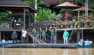Staff waving goodbye to us from the Kinabatangan Riverside Lodge