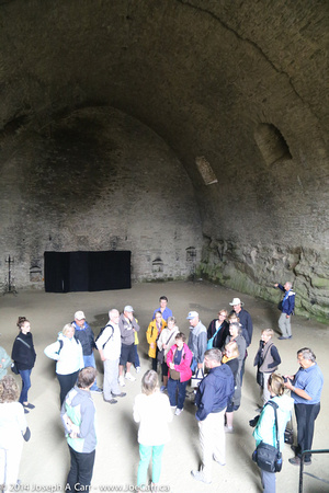The group in a giant storage room inside the castle