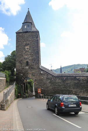 Tower at corner of old stone wall around the town, with roadway