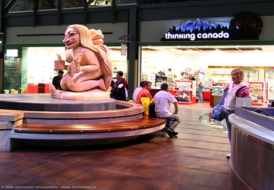 JoeTourist: Victoria to Johannesburg &emdash; Native scupture in the secure departures waiting area