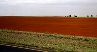 Freshly ploughed farm fields - red dirt