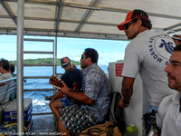 Tahitian guys entertain with music