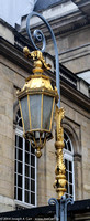 Ornate golden lamp post in the Cour du Mai