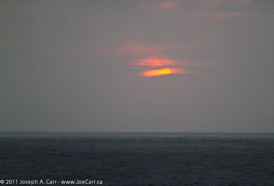 Sunset through the sea fog off the coast of Peru