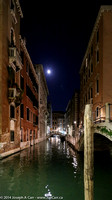Venetian canal at night and an almost Full Moon