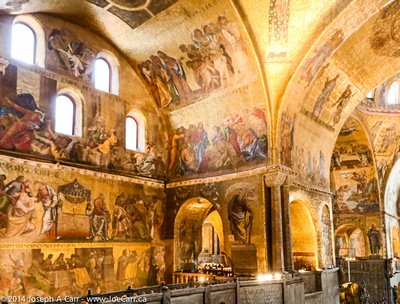 Gold decorated wall and ceiling murals in St. Marks Cathedral