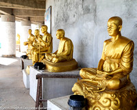 Golden Buddhas with alms bowls