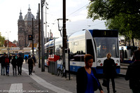 City trams outside the Amsterdam Centraal train station