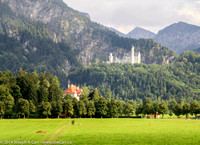 Neuschwanstein Castle in the distant hills